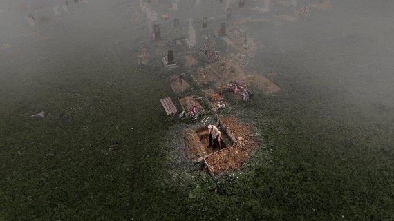 """Six feet under:"" On a foggy morning in Ukraine, the photographer spotted a man digging a grave with ... [+] David Carbonell @davidedziegler, Spain - Agora"