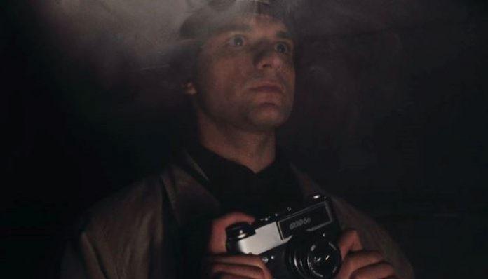 Людина з фотоапаратом